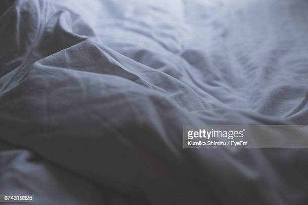 White Color Bed Sheet On Bed