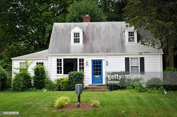 white colored house with blue door - small stock pictures, royalty-free photos & images