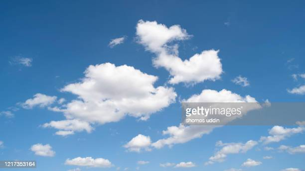 white colour clouds against blue sky - cloud sky stock pictures, royalty-free photos & images
