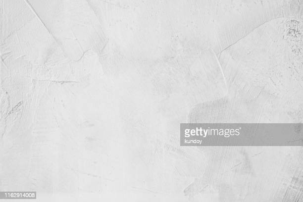 white concrete texture with grunge in daylight. vintage and loft background. - muur stockfoto's en -beelden