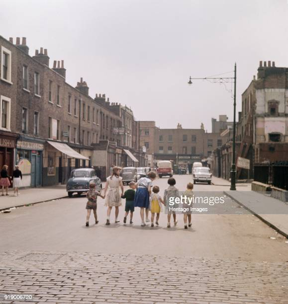 White Conduit Street Islington London circa 1950scirca 1960s A line of children hold hands as they walk along the middle of White Conduit Street...