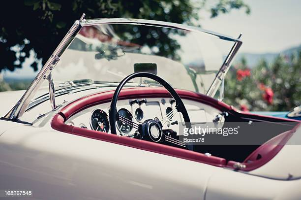 white convertible with red accents on a sunny day - vintage car stock pictures, royalty-free photos & images