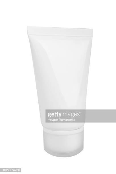 White cosmetic bottle, isolated on white background