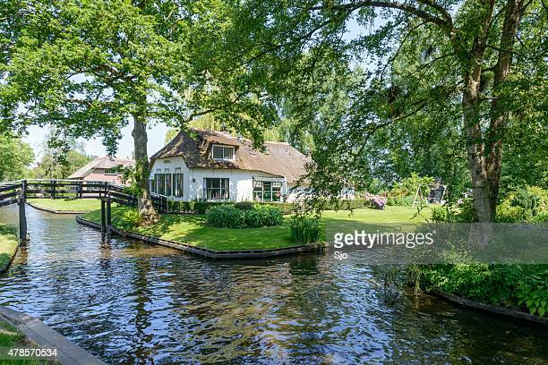White cottage in the village of Giethoorn in The Netherlands.