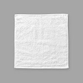 White cotton towel mock up template square size fabric wiper isolated on grey background with clipping path, flat lay top view