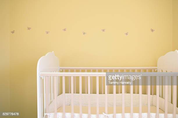 white crib in yellow nursery - empty crib stock photos and pictures