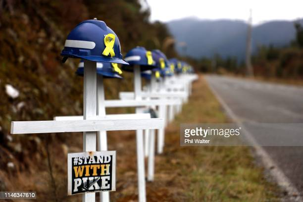 White crosses and saftey helmets are pictured on the access road to the Pike River Mine on May 02, 2019 in Greymouth, New Zealand. 29 men were...
