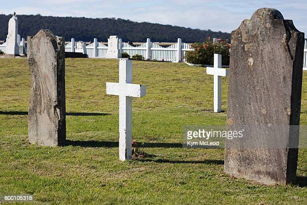 white crosses and tombstones in cemetery - funeral stock pictures, royalty-free photos & images