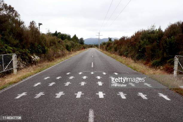White crosses are painted on the access road to the Pike River Mine on May 02, 2019 in Greymouth, New Zealand. 29 men were trapped and killed...