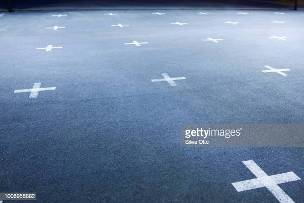 White Crosses on concrete floor