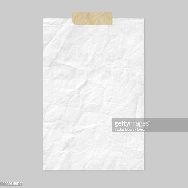 white crumple paper with adhesive tape isolated on gray background - list stock pictures, royalty-free photos & images