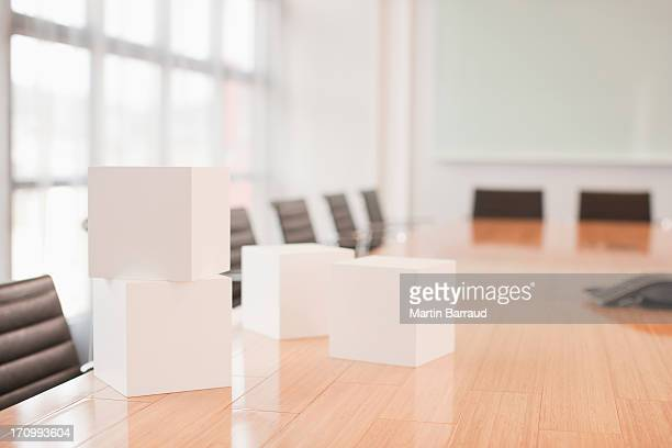 White cubes on conference room table