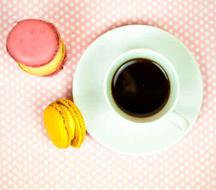 White cup of black coffee, served on white saucer with macaroons biscuits - gettyimageskorea