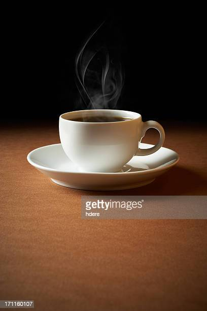 White cup of coffee sends up steam
