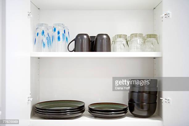 white cupboard with pewter glasses and dishes - dana white stock pictures, royalty-free photos & images