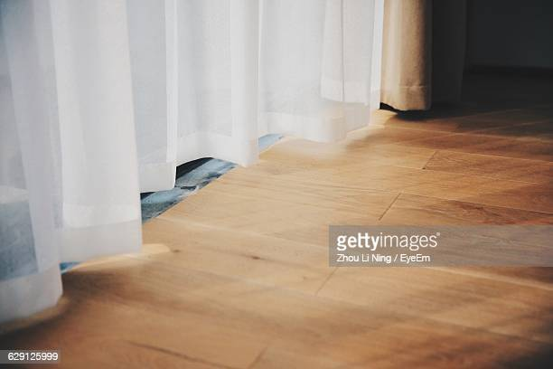 White Curtain And Hardwood Floor At Home