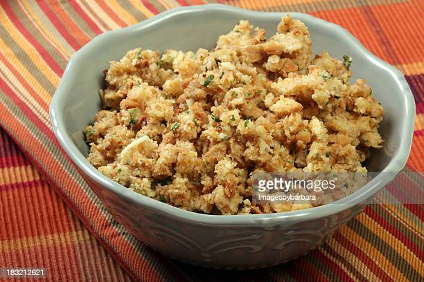 white decorative bowl of stuffing on a striped tablecloth - stuffing stock photos and pictures