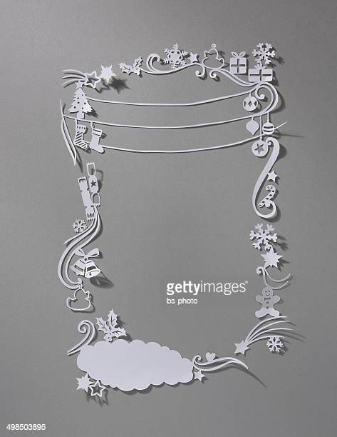 white delicate paper cut out christmas ornament