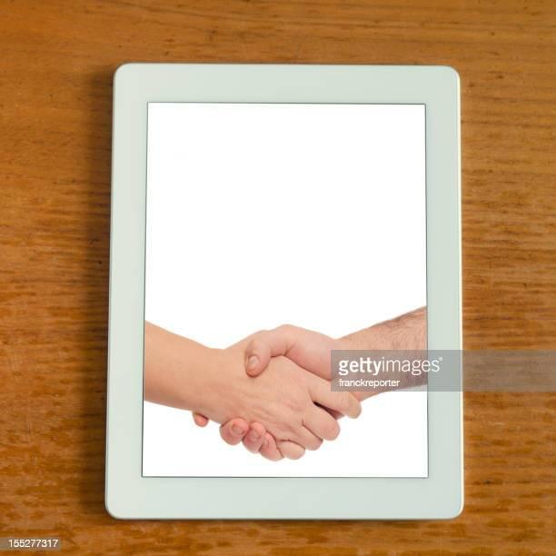 White digitalen tablet mit handshake-Foto