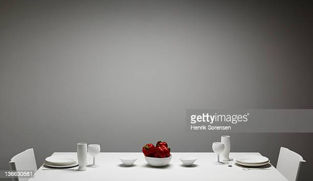 White dinner table with red pepper