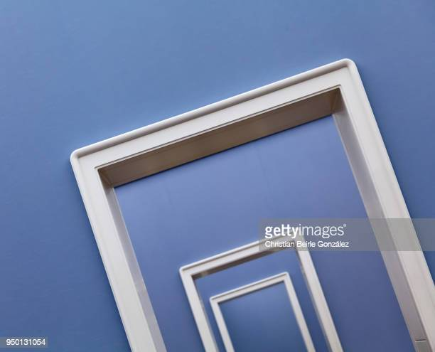 white doorframes on blue wall - christian beirle gonzález stock pictures, royalty-free photos & images