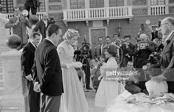 A white dove is presented to American actress Grace Kelly and Prince Rainier III of Monaco as a gift from the people of Monaco after their civil...