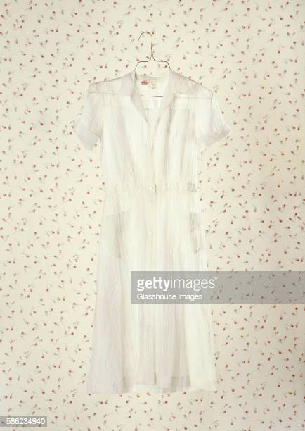 white dress on wallpaper - white dress stock pictures, royalty-free photos & images