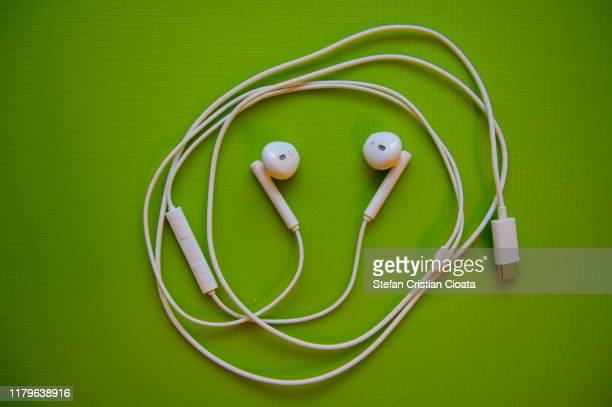 white earphones - colors soundtrack stock pictures, royalty-free photos & images