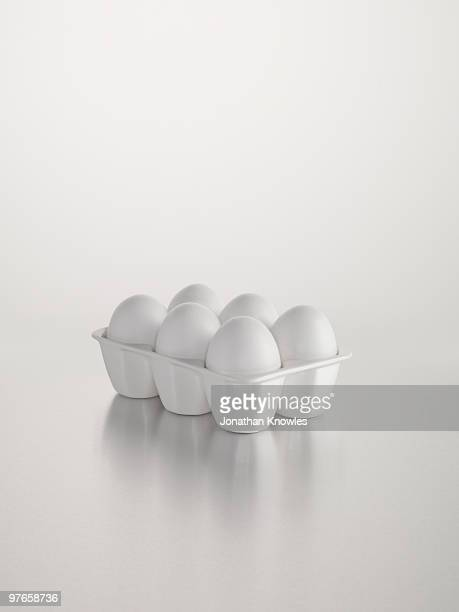 White egg holder against white background