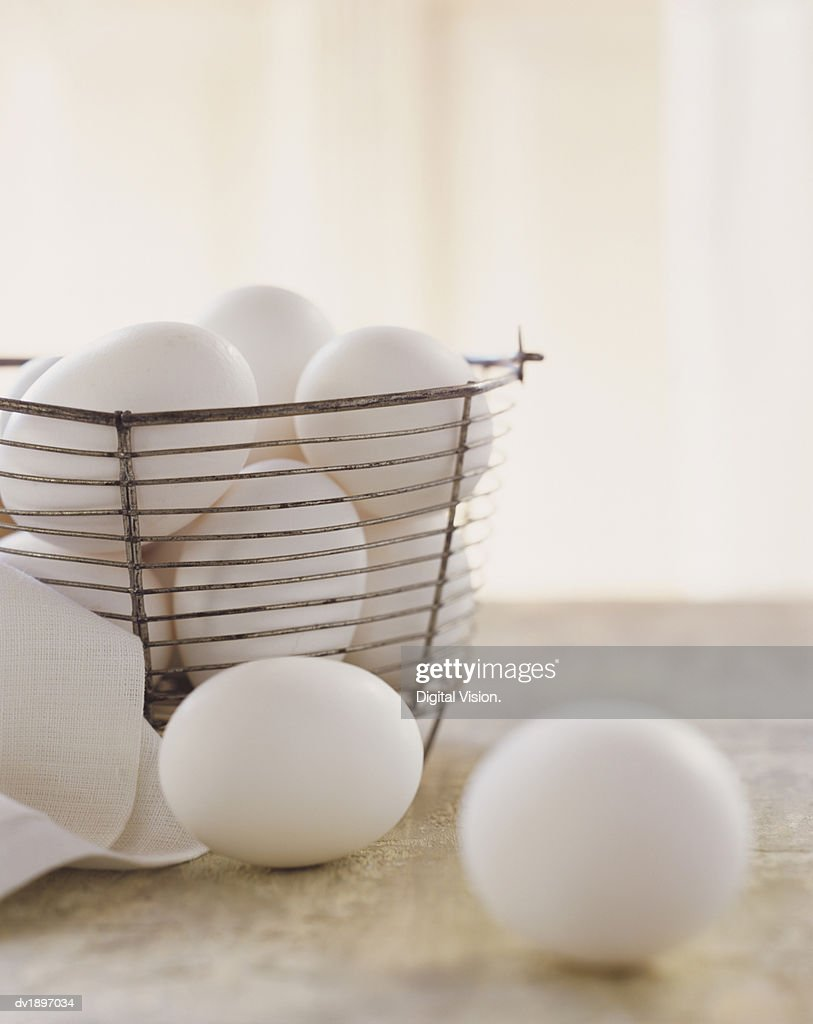 White Eggs in Basket : Stock Photo