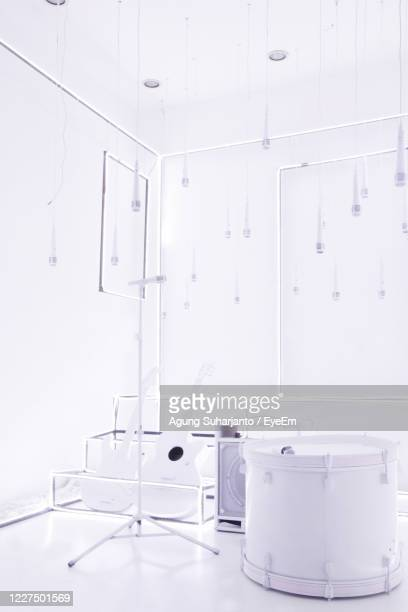 white electric lamp on table against wall - art show stock pictures, royalty-free photos & images