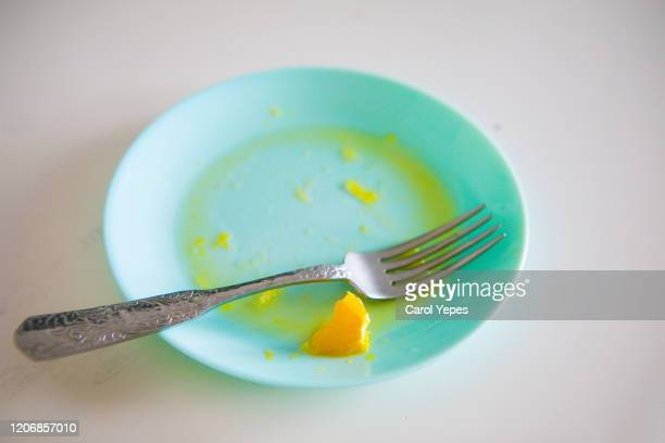 white empty plate with piece of orange - messy table after party stock pictures, royalty-free photos & images