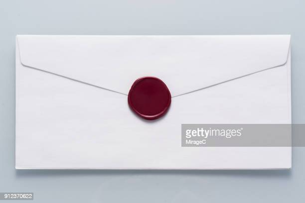 White Envelope Sealed with Wax Stamp