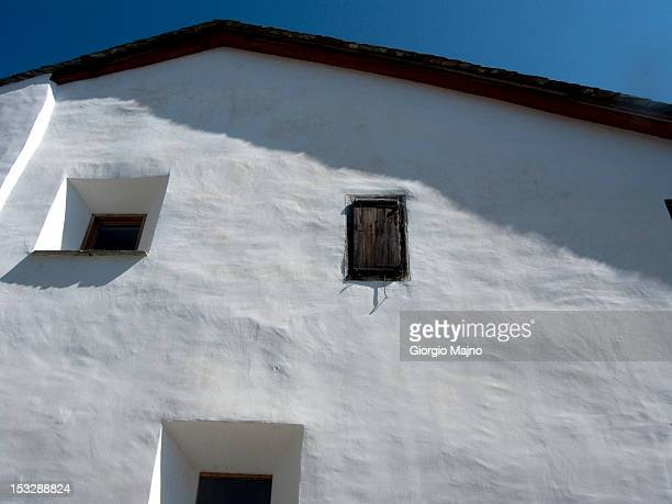 white facade of an old building with three windows - asymmetry stock pictures, royalty-free photos & images