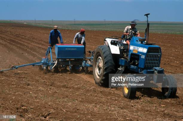 A white farmer works his fields with his tractor June 22 2001 outside Vryburg a farming town about 400 kilometers west of Johannesburg South Africa...
