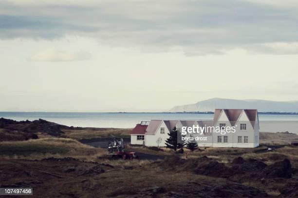 White farmhouse at the sea