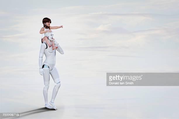 white female cyborg carrying girl on shoulders - cyborg stockfoto's en -beelden