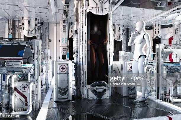 White female cyborg watching person in cylinder