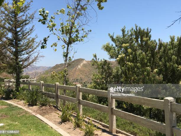 a white fence leads the eye to the mountains of simi valley in ca., usa. - simi valley stock photos and pictures