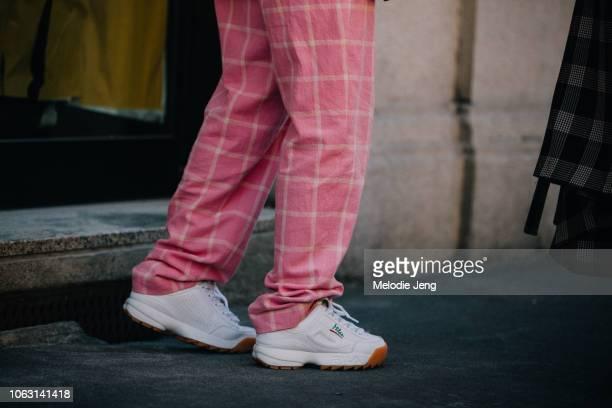 White Fila sneakers seen during Milan Fashion Week Spring/Summer 2019 on September 23 2018 in Milan Italy