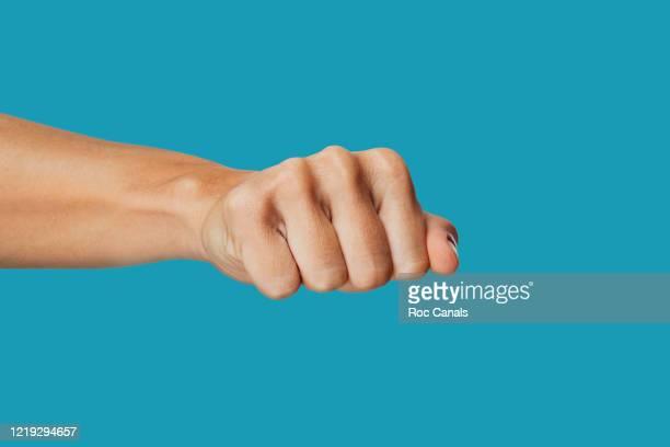 white fist - poing photos et images de collection