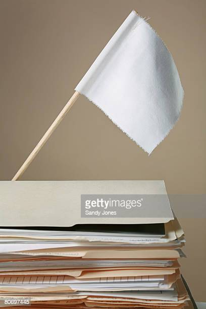 white flag over file folders