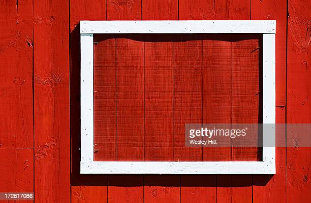 White frame on red wall