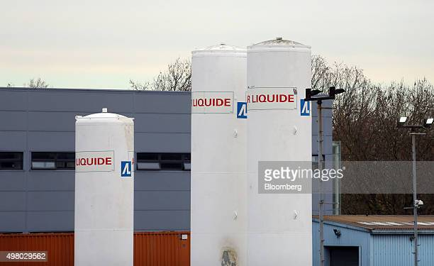 White gas storage tanks are seen standing at the Air Liquide SA distribution site in London UK on Friday Nov 20 2015 Air Liquide's $103 billion...