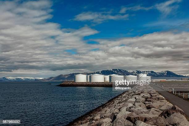 White gas storage tanks in the harbor of Reykjavik, Iceland