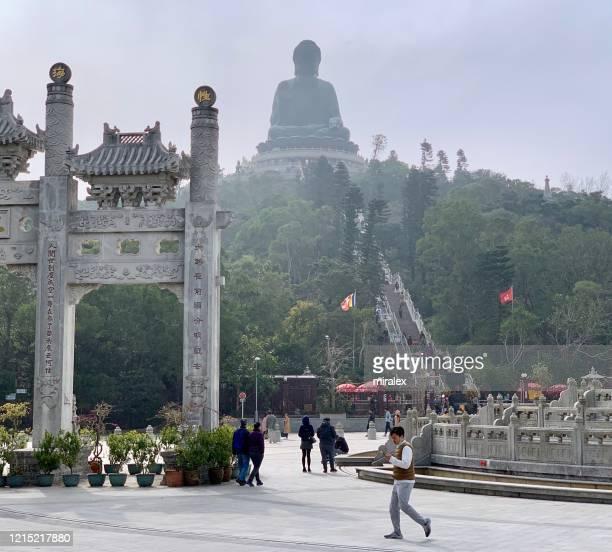 white gate leading to po lin monastery and tian tan buddha - lantau stock pictures, royalty-free photos & images