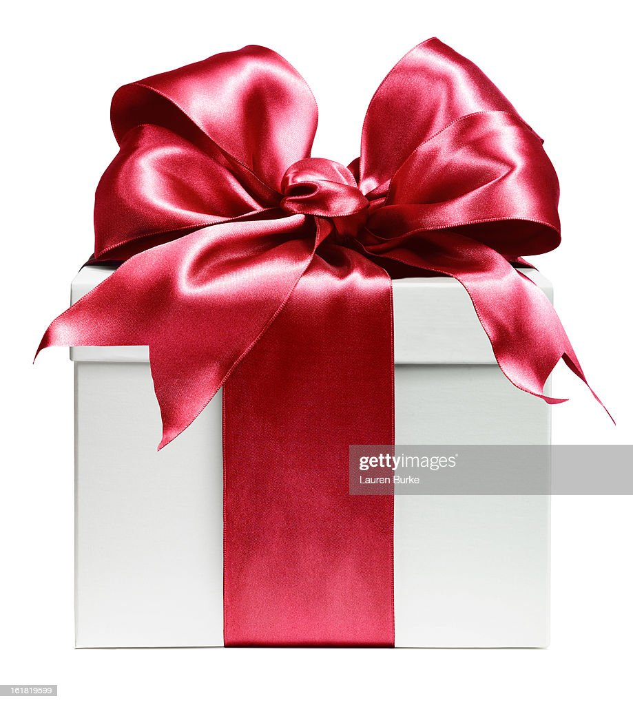 White gift wrapped in red bow : Stock Photo