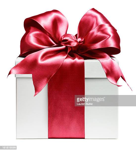 white gift wrapped in red bow - gift stock pictures, royalty-free photos & images