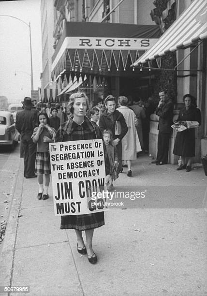 White girl joining African Americans picketing Rich's Department Store over lunch counter segregation.