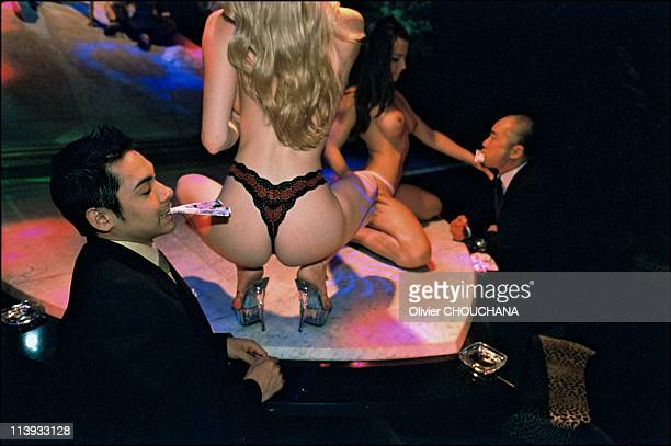 White girls strip for Japanese men in Seventh Heaven strip joint In Tokyo Japan On July 2002
